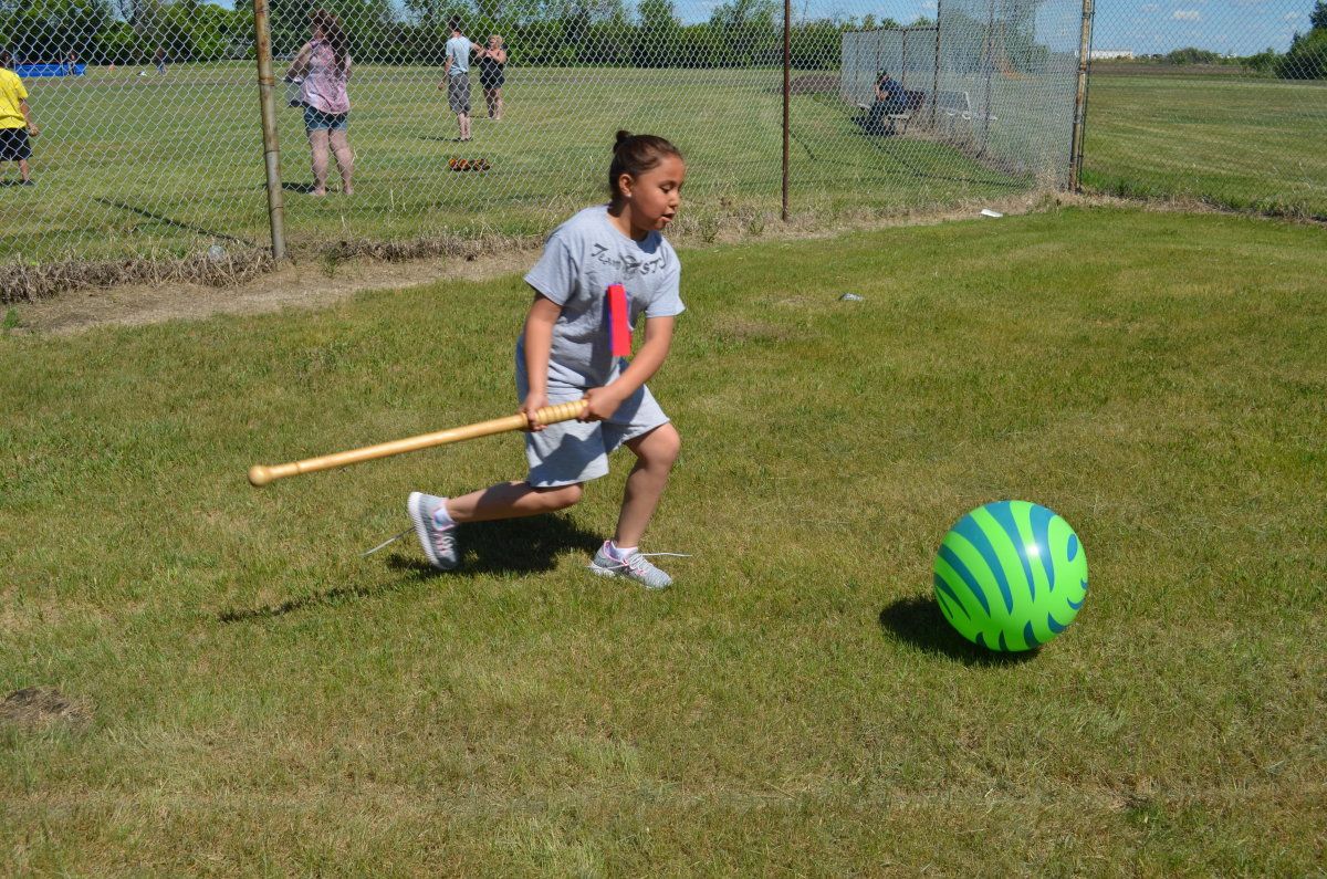 Student demonstrating how to play Pitchball