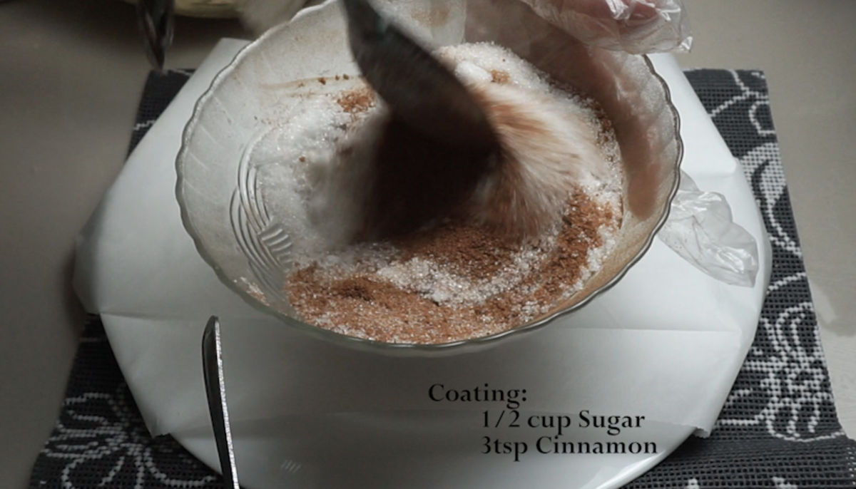 Prepare the mixture of ground cinnamon and granulated sugar in a small mixing bowl.
