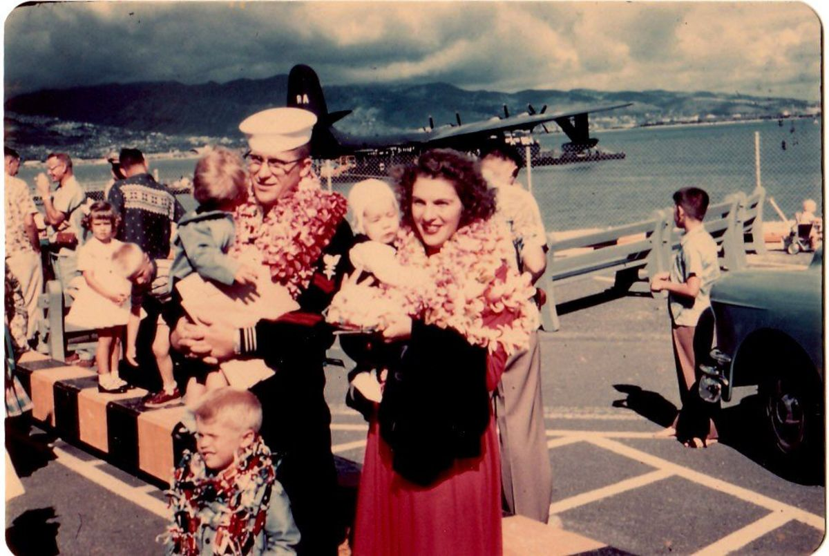In the arms of my daddy.  Leaving Oahu on a military plane for California.