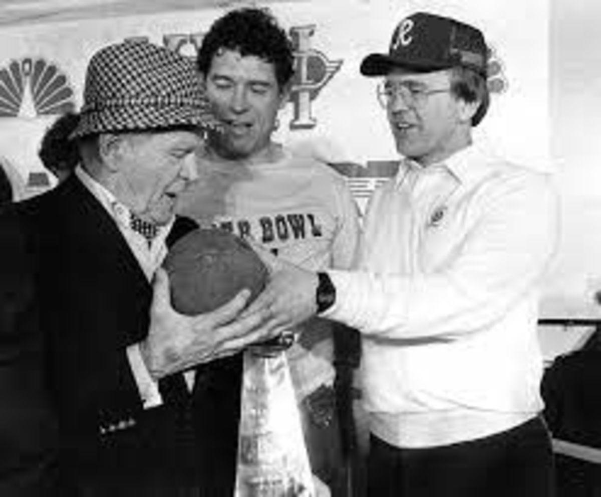 Owner Jack Kent Cooke, Fullback John Riggins, and Coach Joe Gibbs celebrate their back-to-back Super Bowl victory