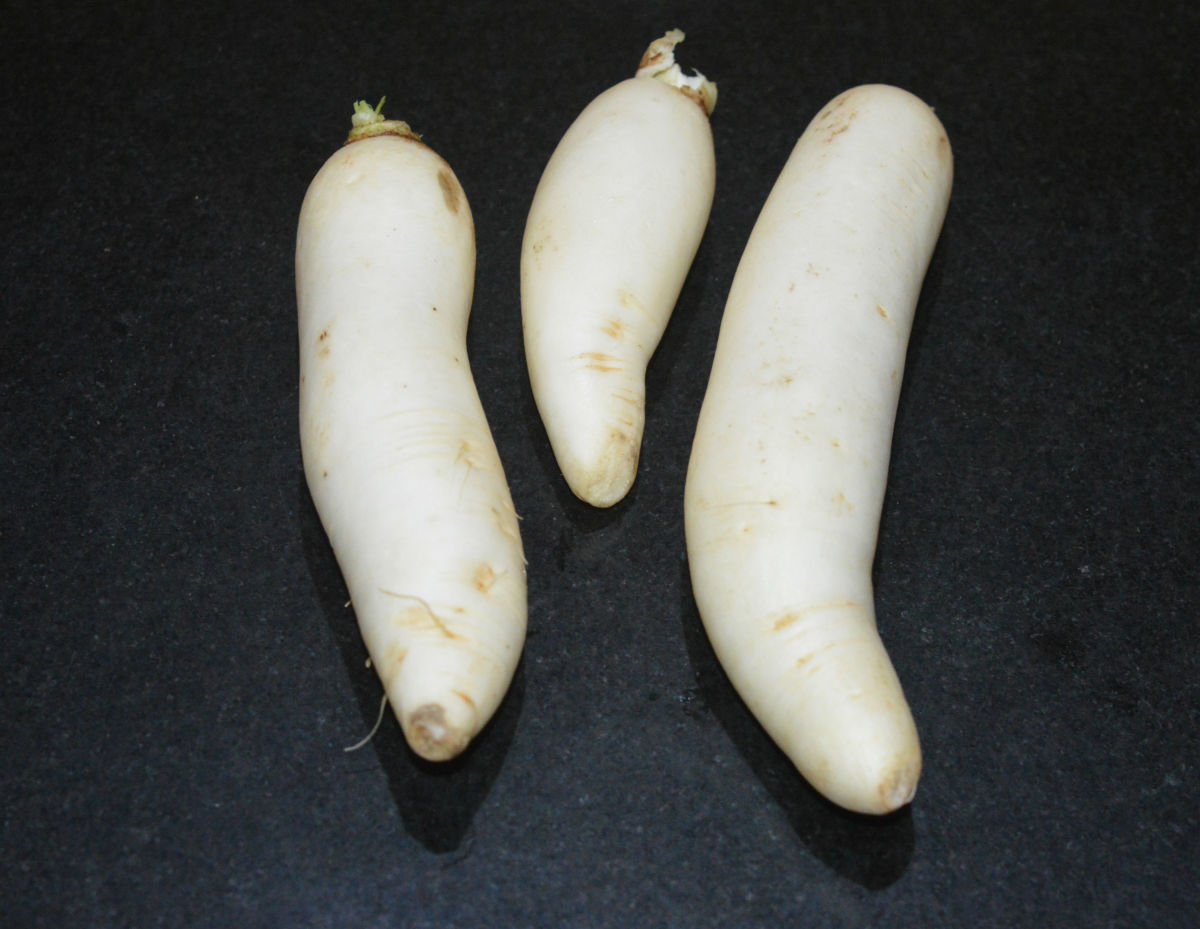 Step one: Wash radish and peel them. Grate them. Set aside.