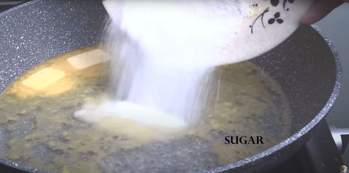 Adding in sugar to the saucepan.