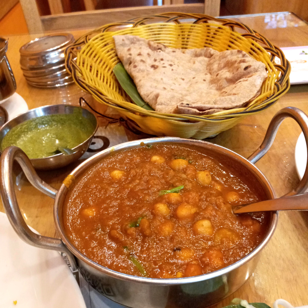 Indian restaurants will often remove the cream, ghee, or other non-vegan ingredients from curries on request.
