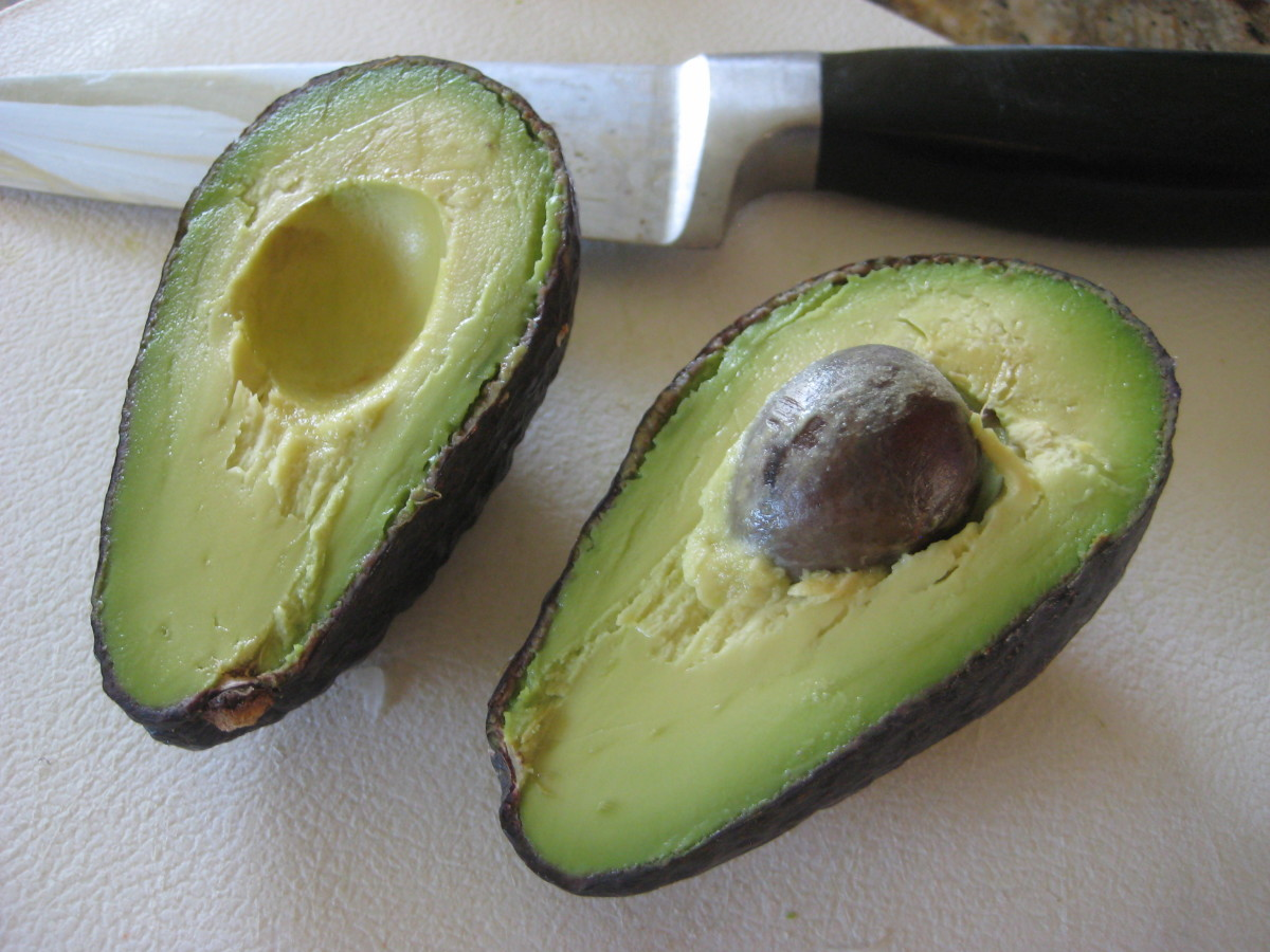 Slice the avocados in half lengthwise and remove the pit.