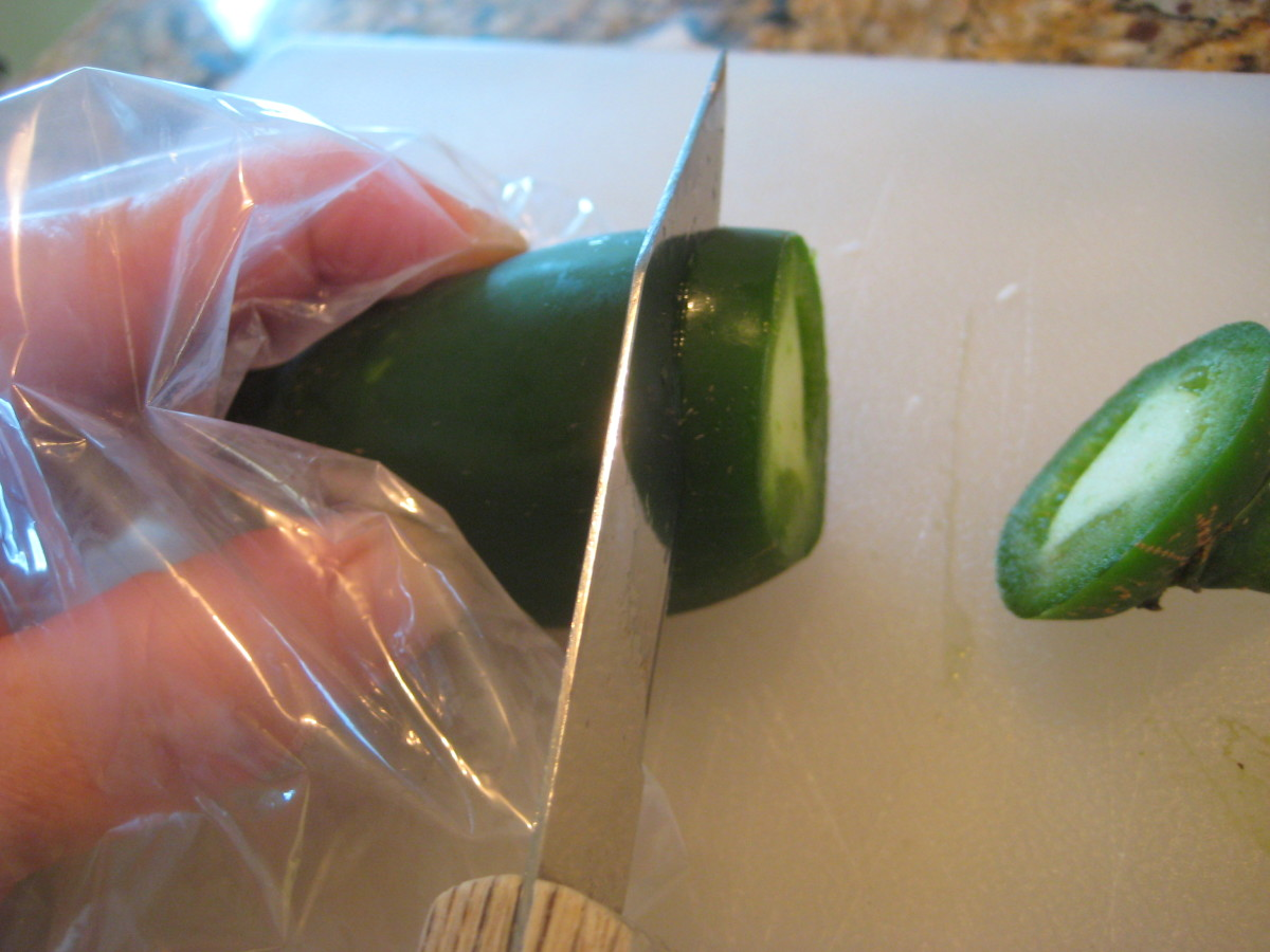 Wear a disposable glove or place a plastic bag over your hand when slicing and chopping jalapenos.
