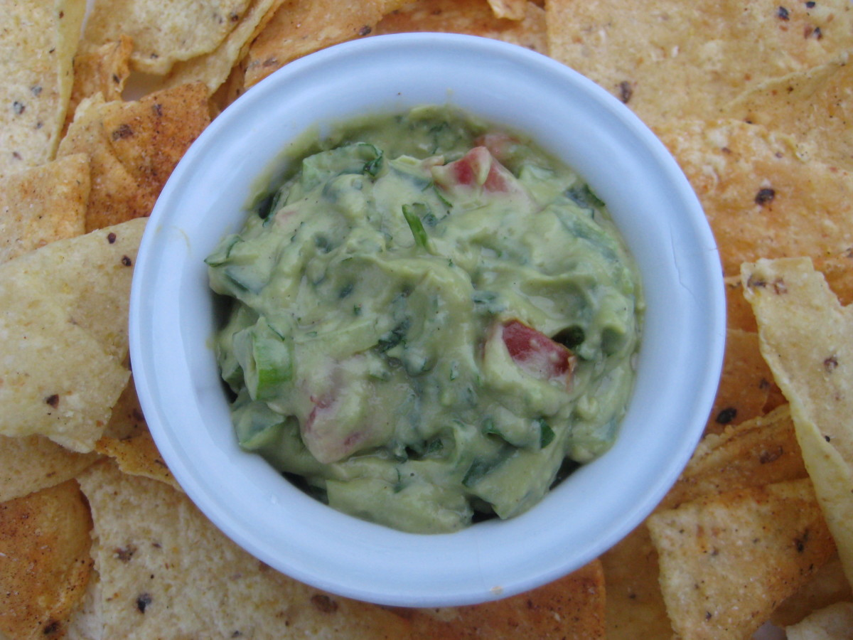Guacamole made with all fresh onions, tomatoes, peppers and cilantro.