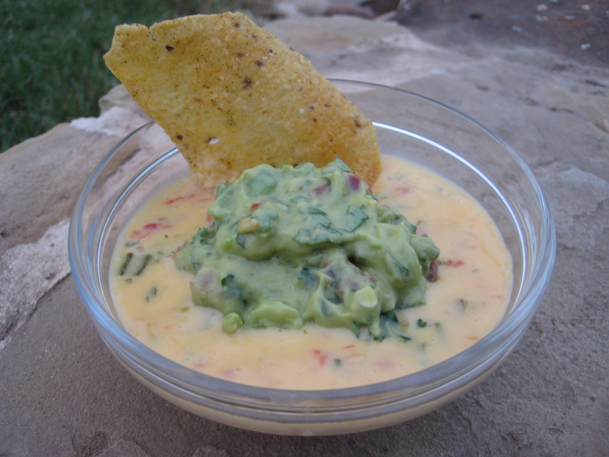Spoon a shallow layer of queso into a small bowl, then place a scoop of guacamole in the middle of it. Yum!