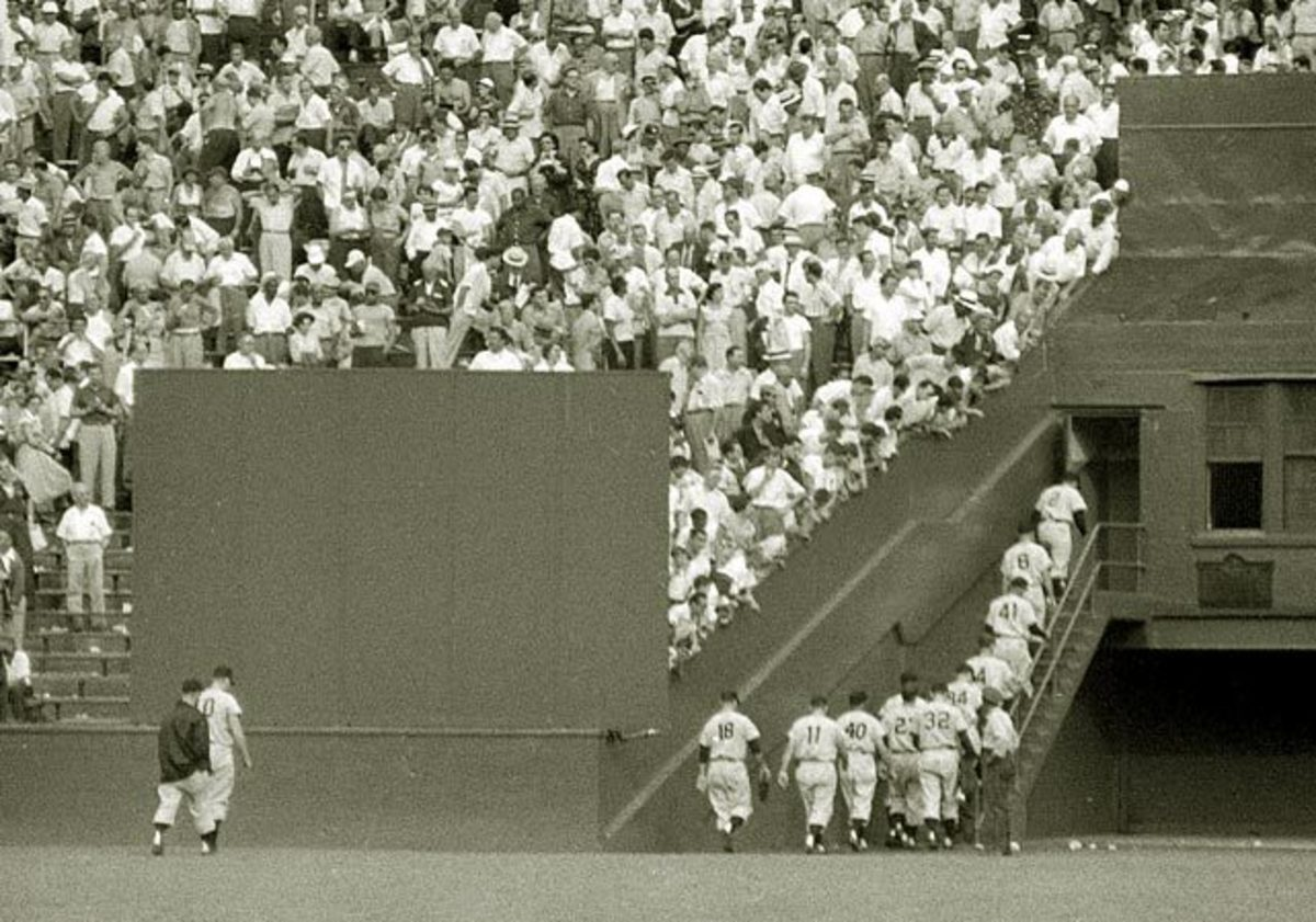 1954 - The Giants head into their clubhouse between games of a doubleheader.