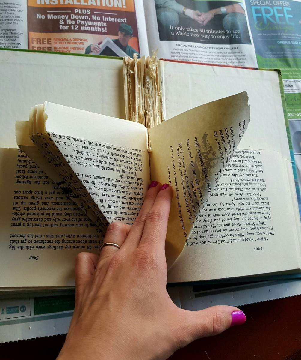 Continue folding the entire right side of the book, page by page.