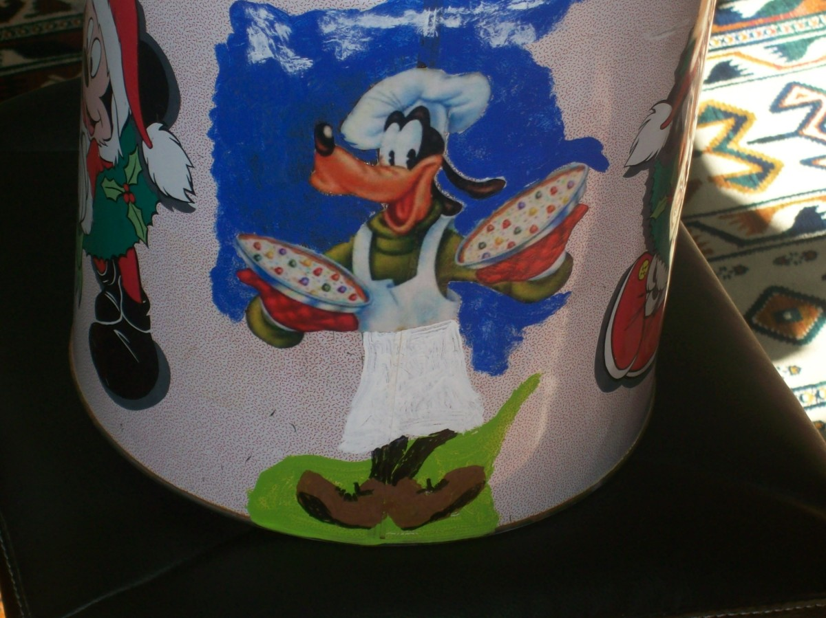 A popcorn container painted and decoupaged with my favorite character, Goofy.