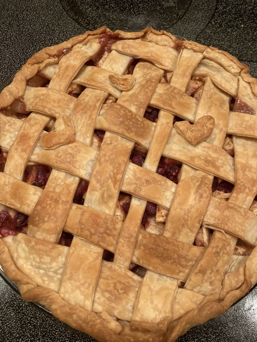 Apple pomegranate pie is the perfect blend of sweet, tart, and cinnamon spice.