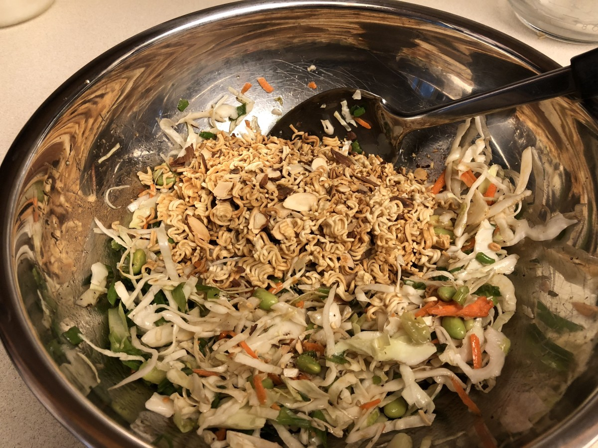 Add toasted noodles and almonds to cabbage mixture