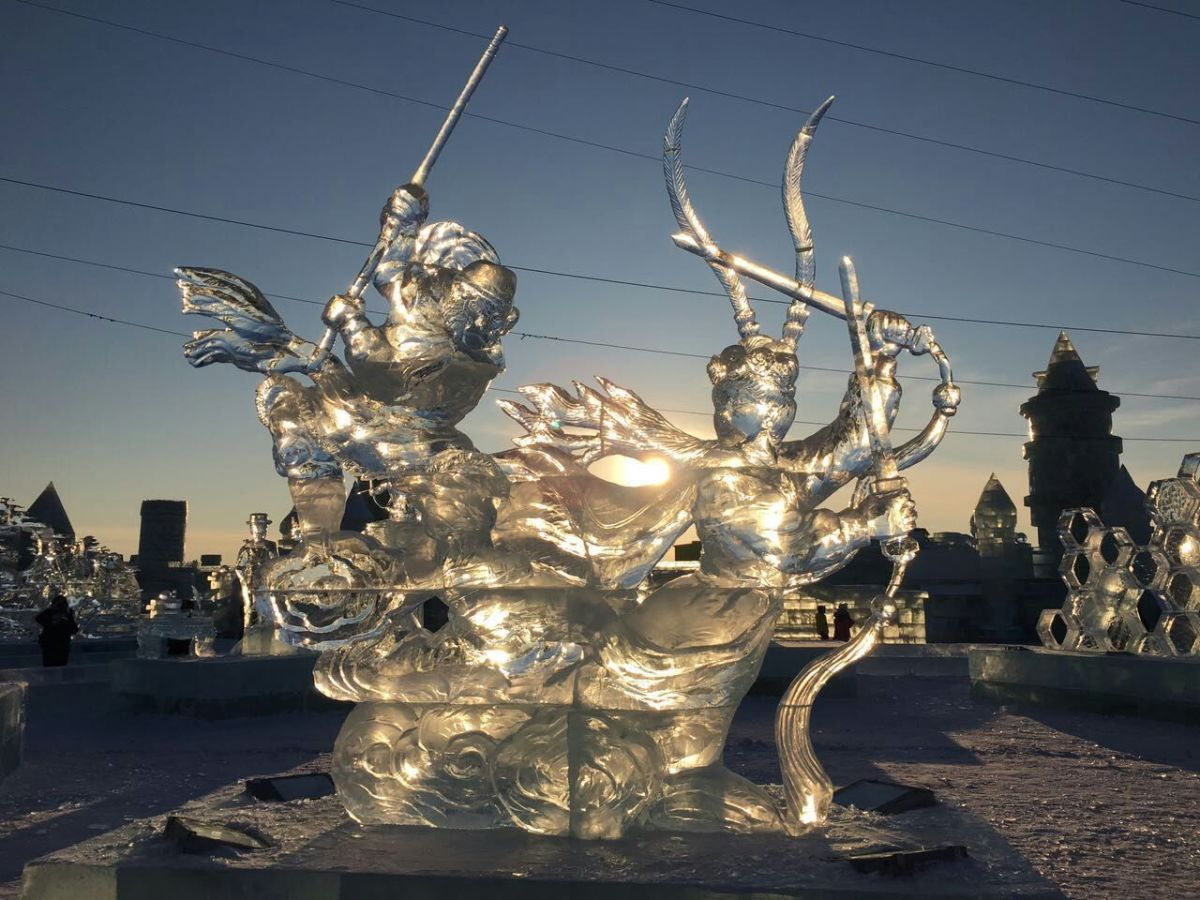 The sunset, photographed through a sculpture.