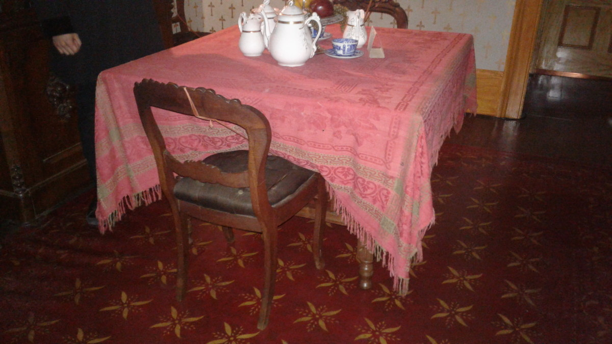 The table and chairs where the little girl is seen