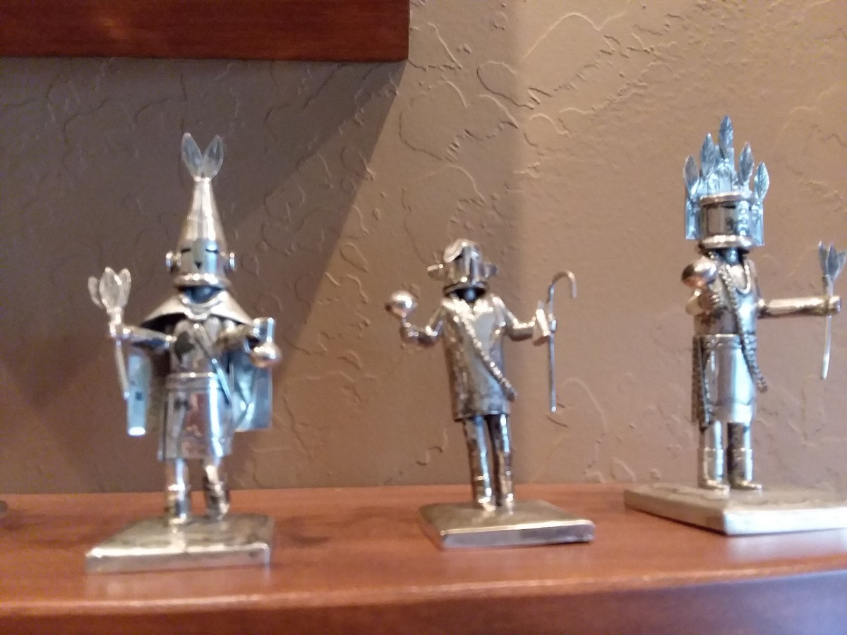 Miniature Kachinas in silver by Santa Fe Navajo artist Jeffery Castillo.