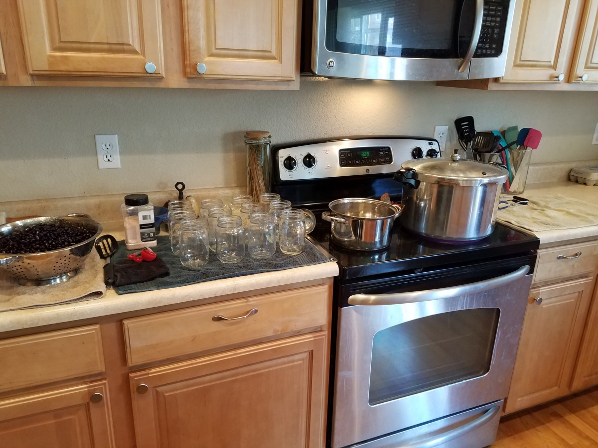 Set out your pressure canning station. You'll need your pressure canner and a large pot of water to boil, clean pint canning jars with lids and rings, a large ladle, a canning kit of tools needed for canning, salt, measuring spoons, and a towel.