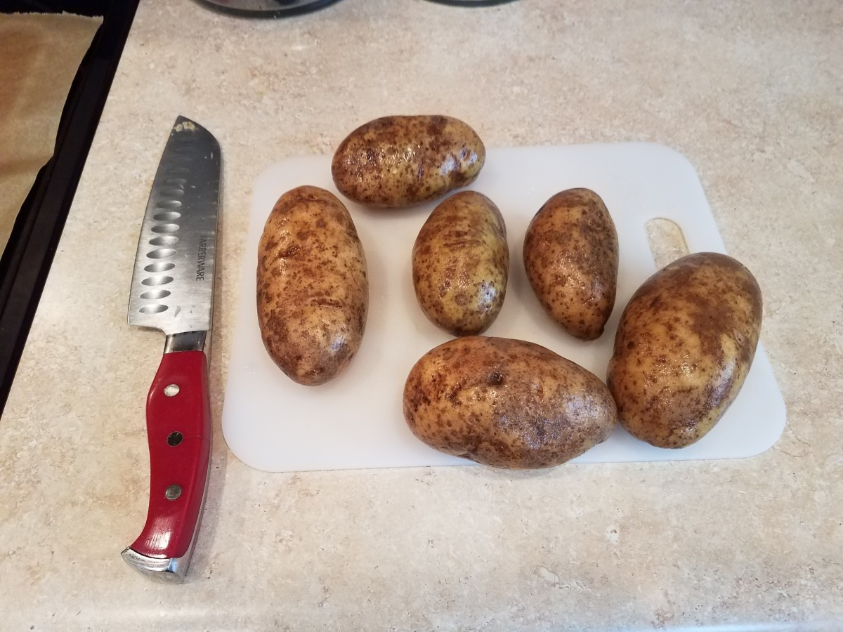 Wash and slice 6 potatoes into 1/8ths.