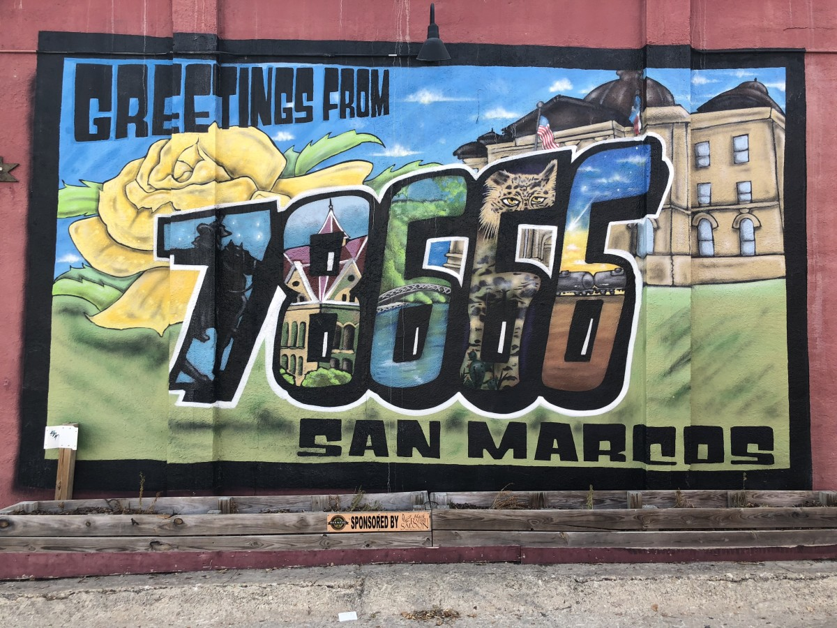 A mural welcoming visitors to San Marcos, Texas.