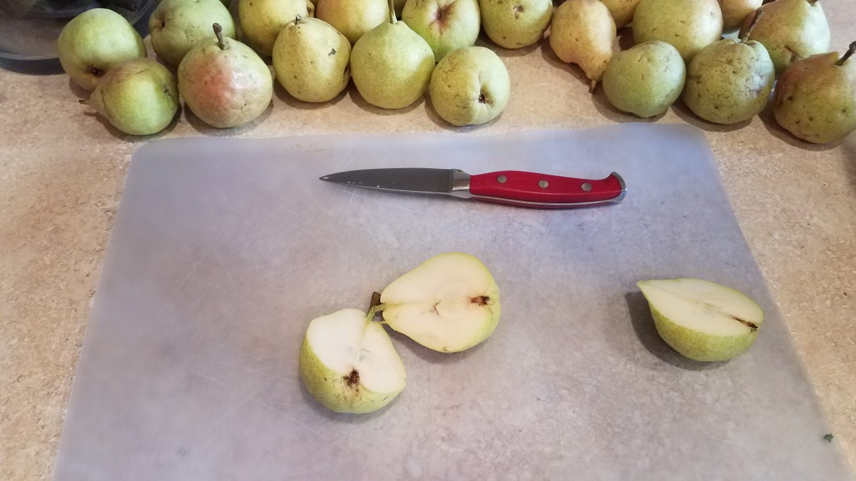 Slice each pear in half.