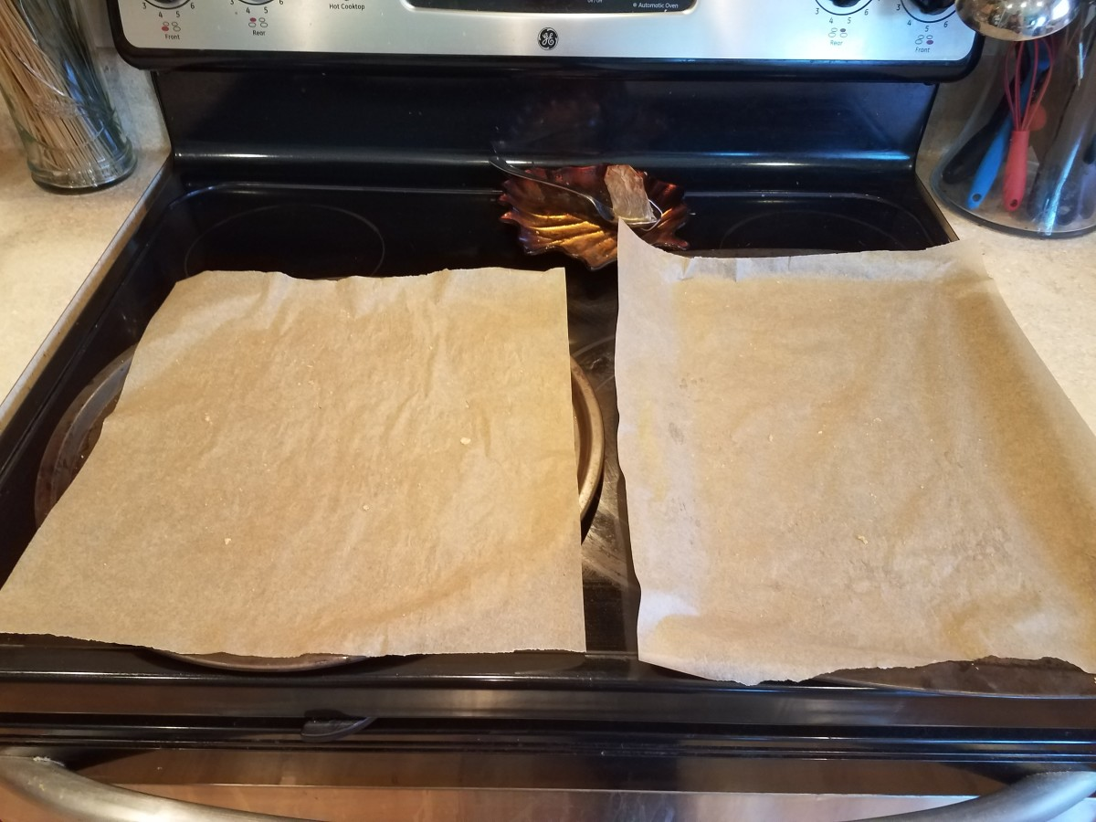 Preheat your oven and line your cookie sheets with parchment paper.