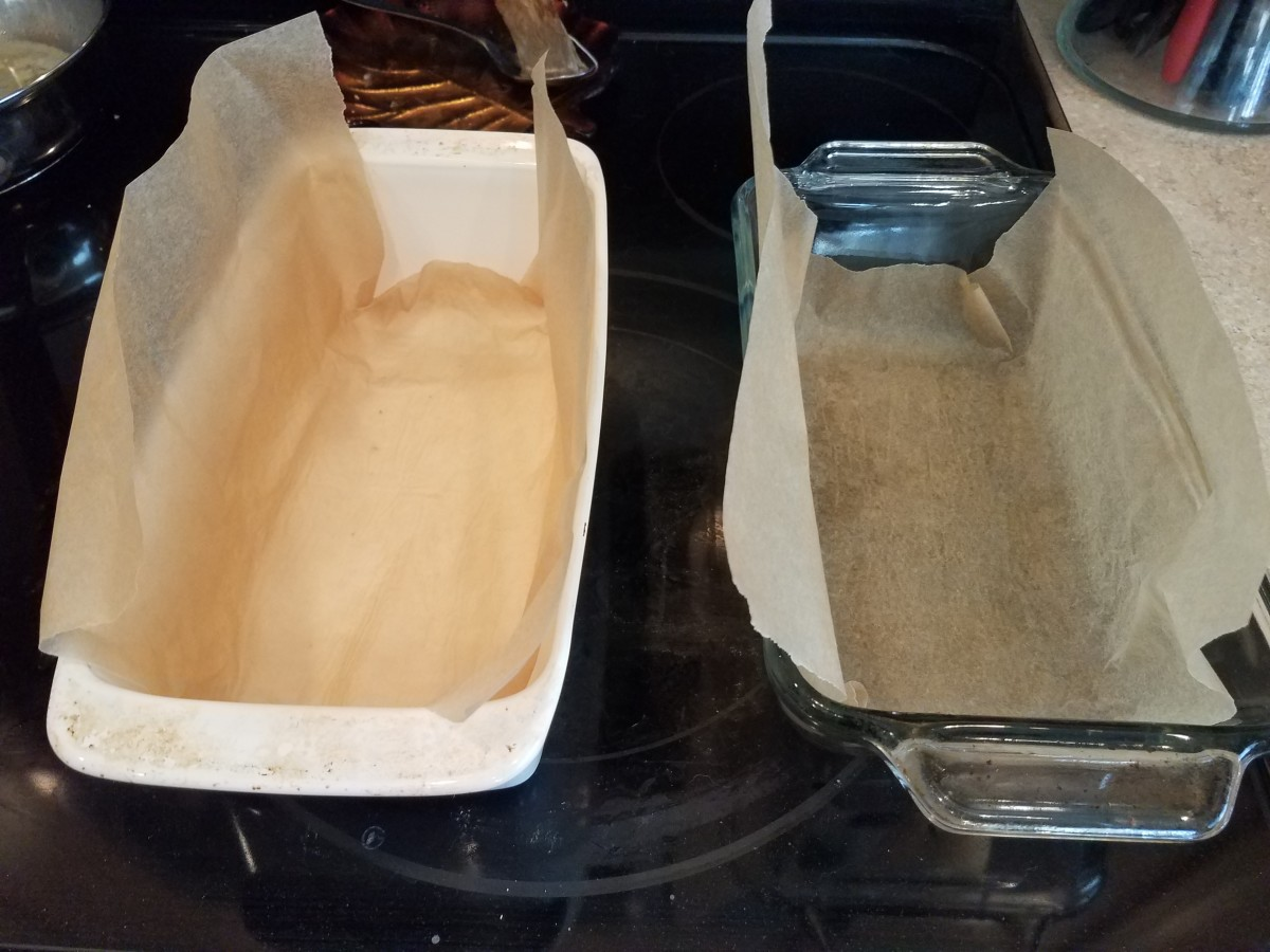 Line two loaf pans with parchment paper.