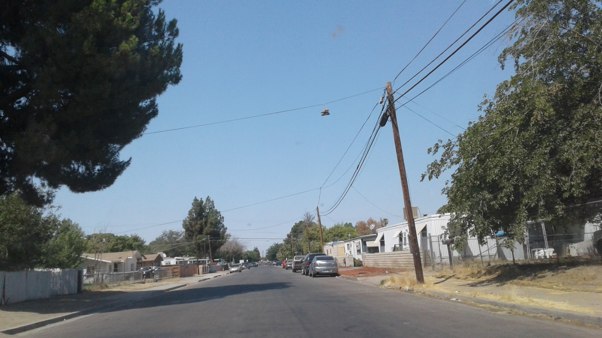 Sneakers hanging from an electrical wire along Beardsley Avenue