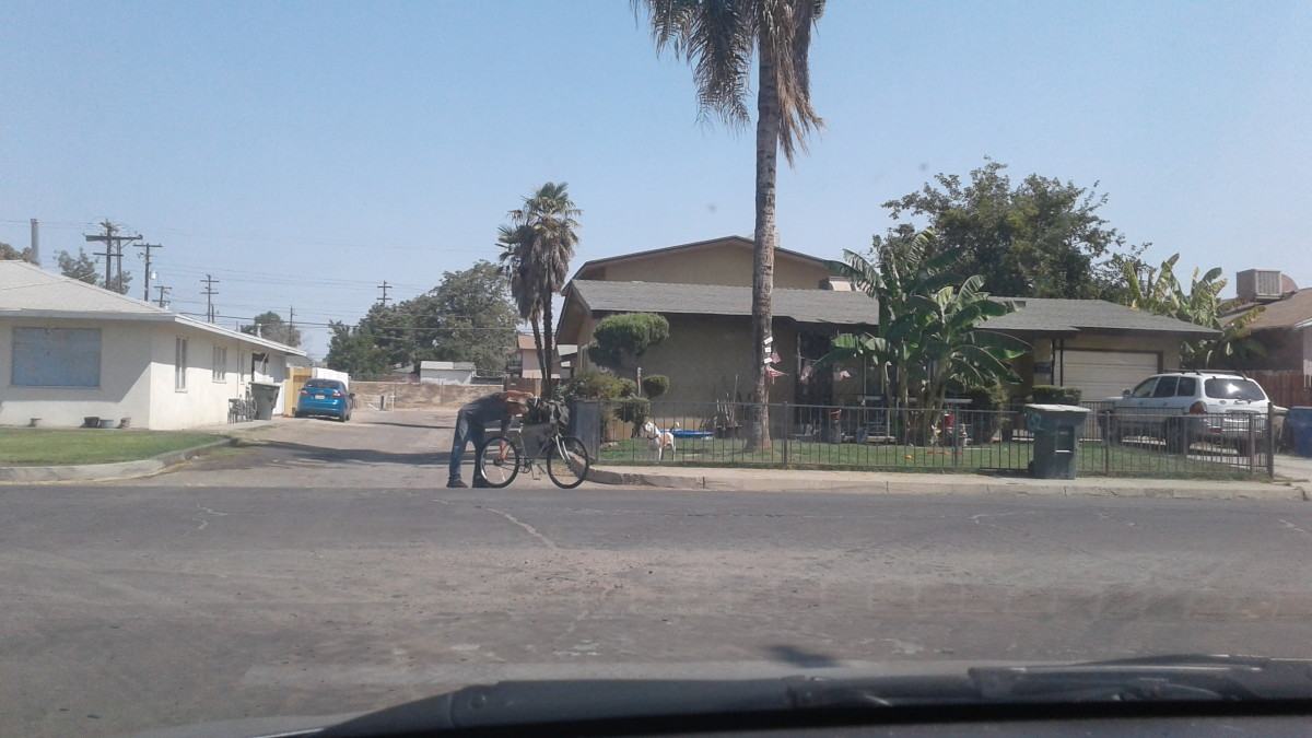 A man double checks his bicycle near Chester Avenue