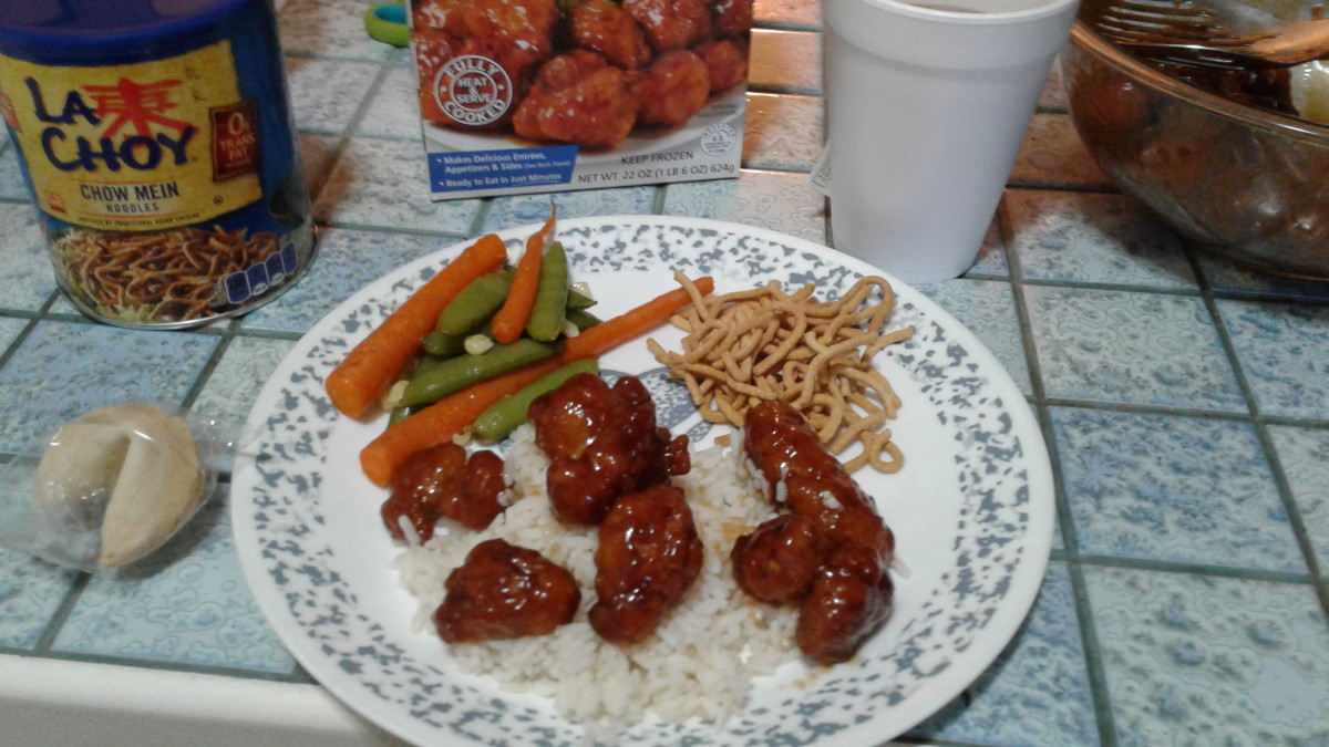 Over rice with a side of veggies and chow mien pieces