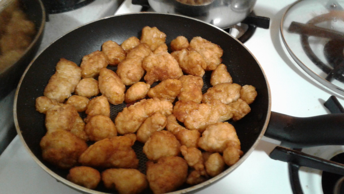 Place chicken nuggets (already cooked) in heated oil