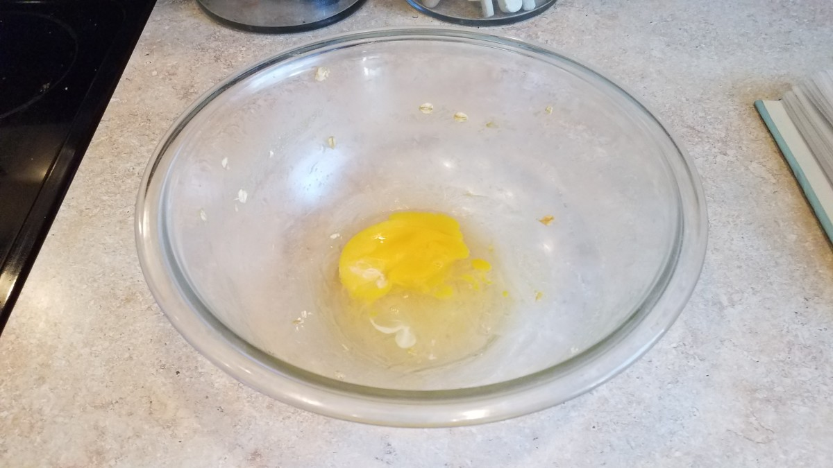 Add an egg to your mixing bowl.