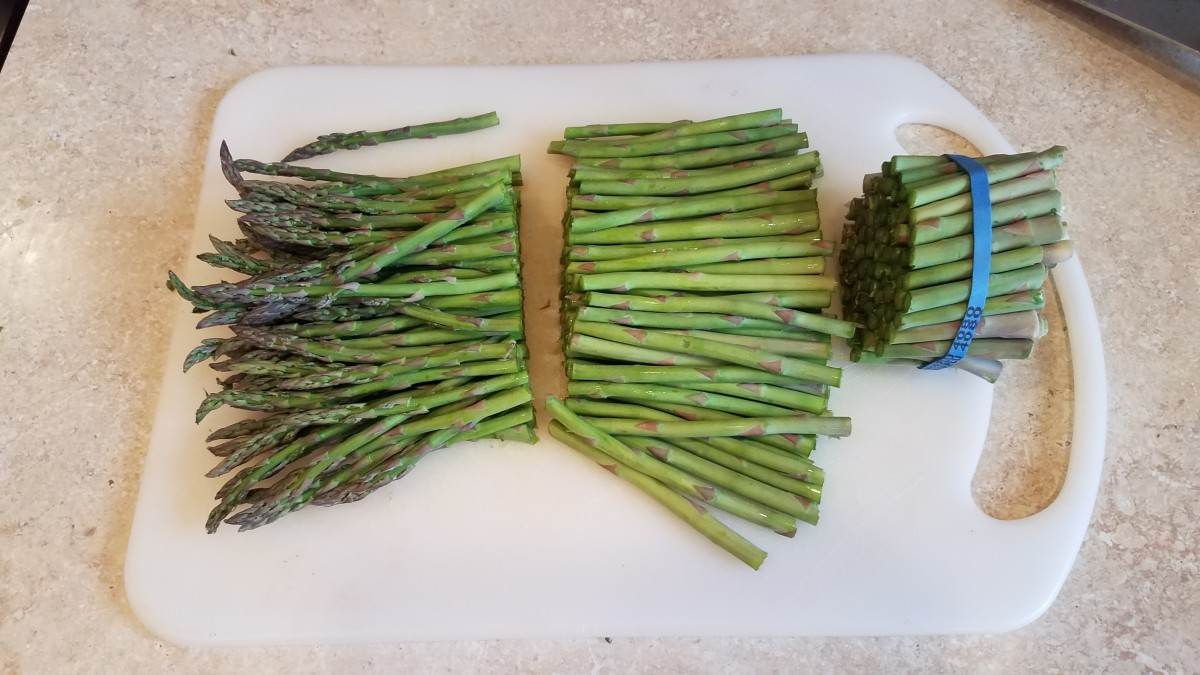 Cut the ends off of your asparagus and cut them in half.