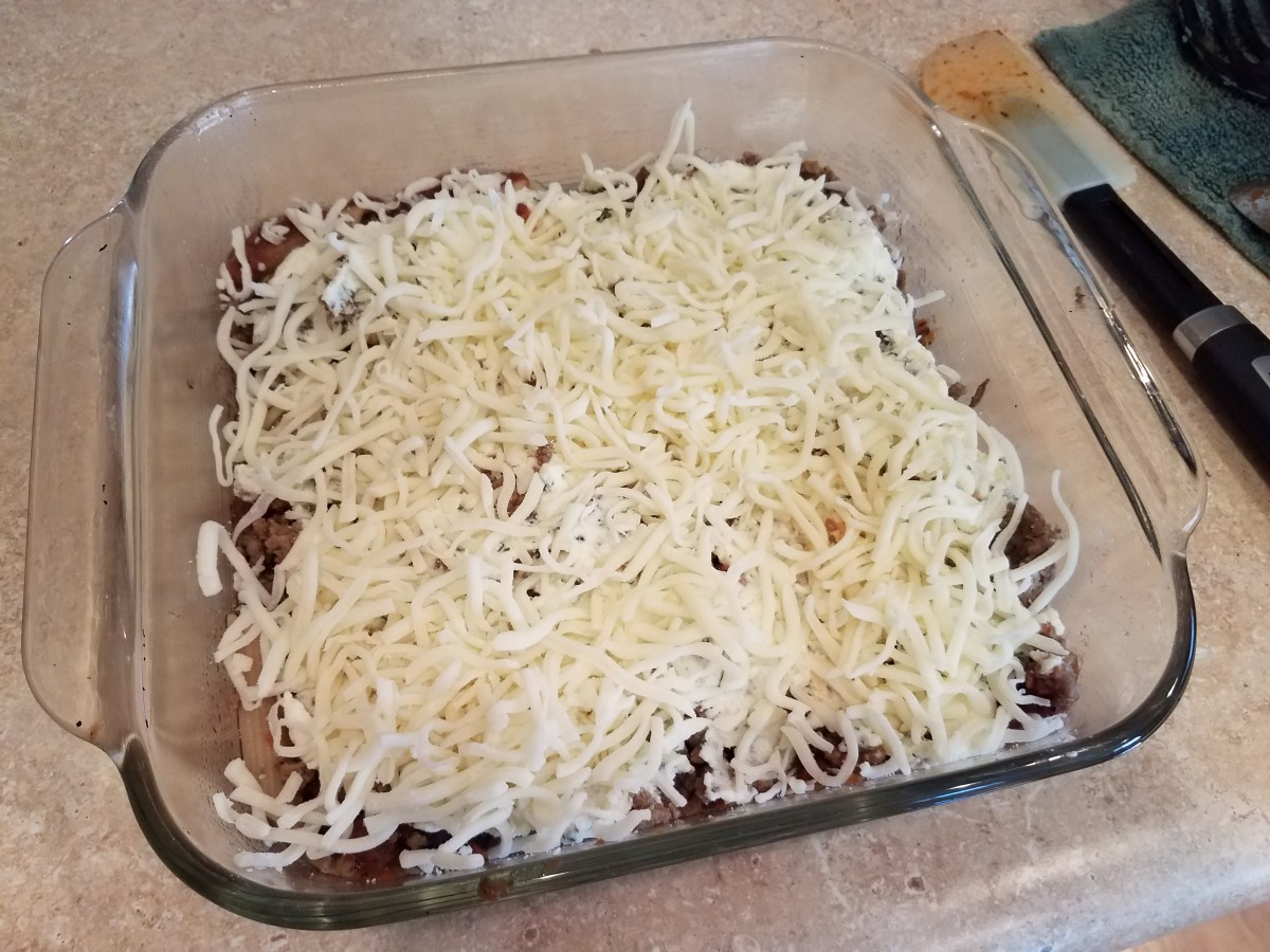 Step Nine: Spread half of your mozzarella on top.