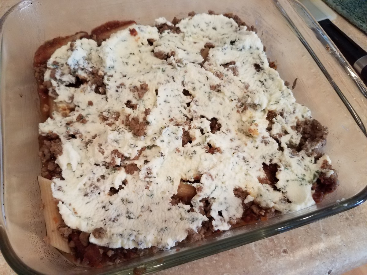 Step Eight: Spread half of the ricotta mixture onto the top of the dish.