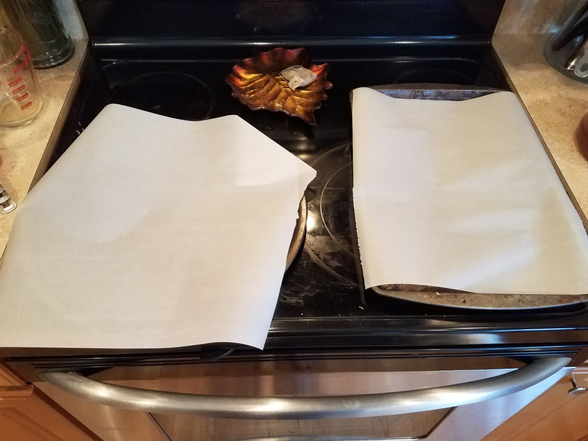 Step Six: Line two cookie sheets with parchment paper.
