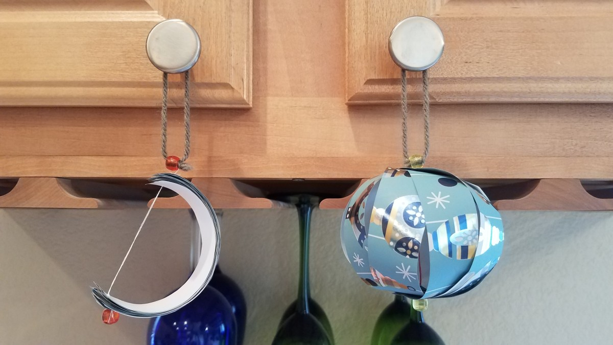 A paper ball ornament: closed (left) and open (right).