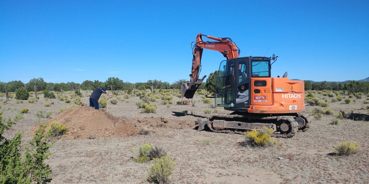 An excavator digs site test holes—deep, sloping trenches, actually—on our property in the area we preferred to build.