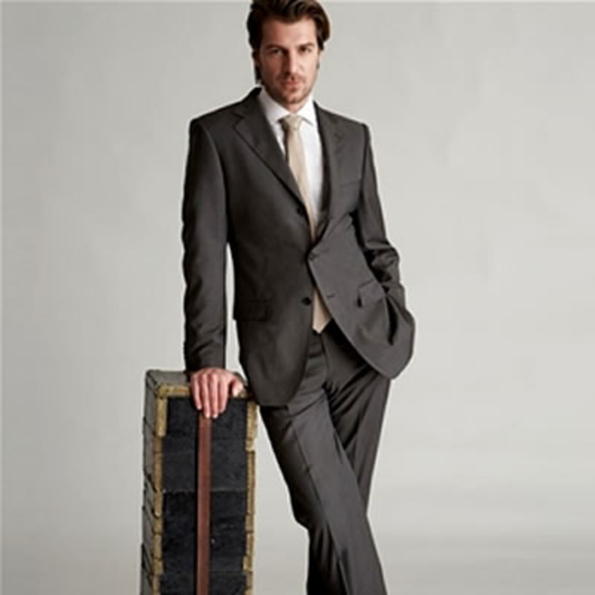 Men in grey suits look professional if not hygiene challenged.