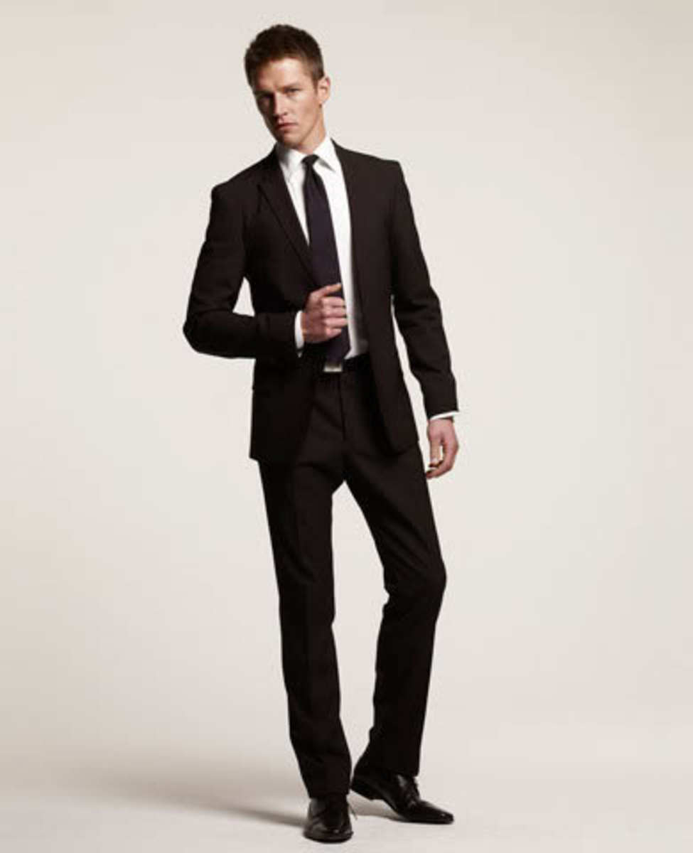 A career ready man in his suit has make sure he is hygiene safe.