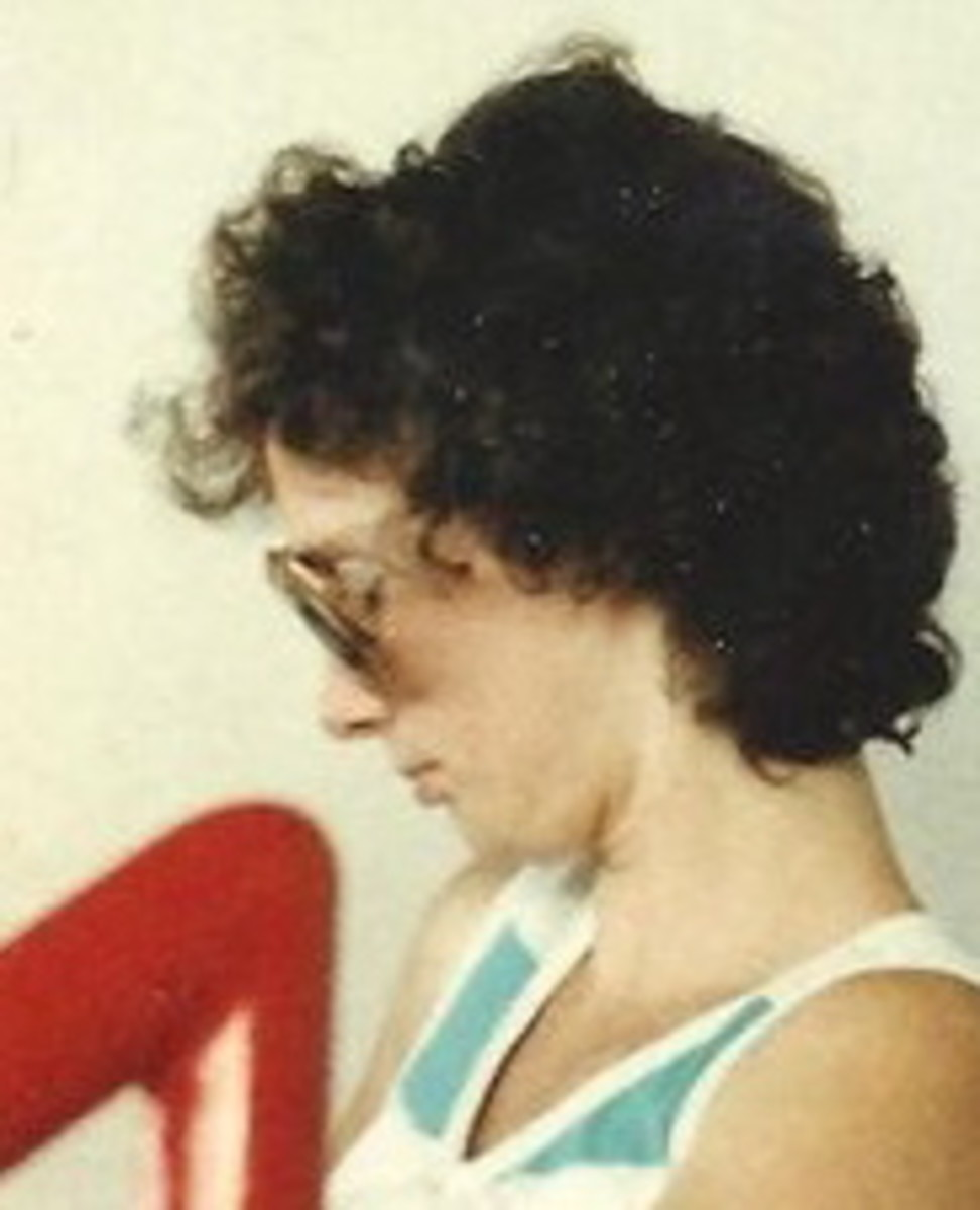 This was my idea of trendy 80's perm. I look like I stuck my tongue in a light socket.