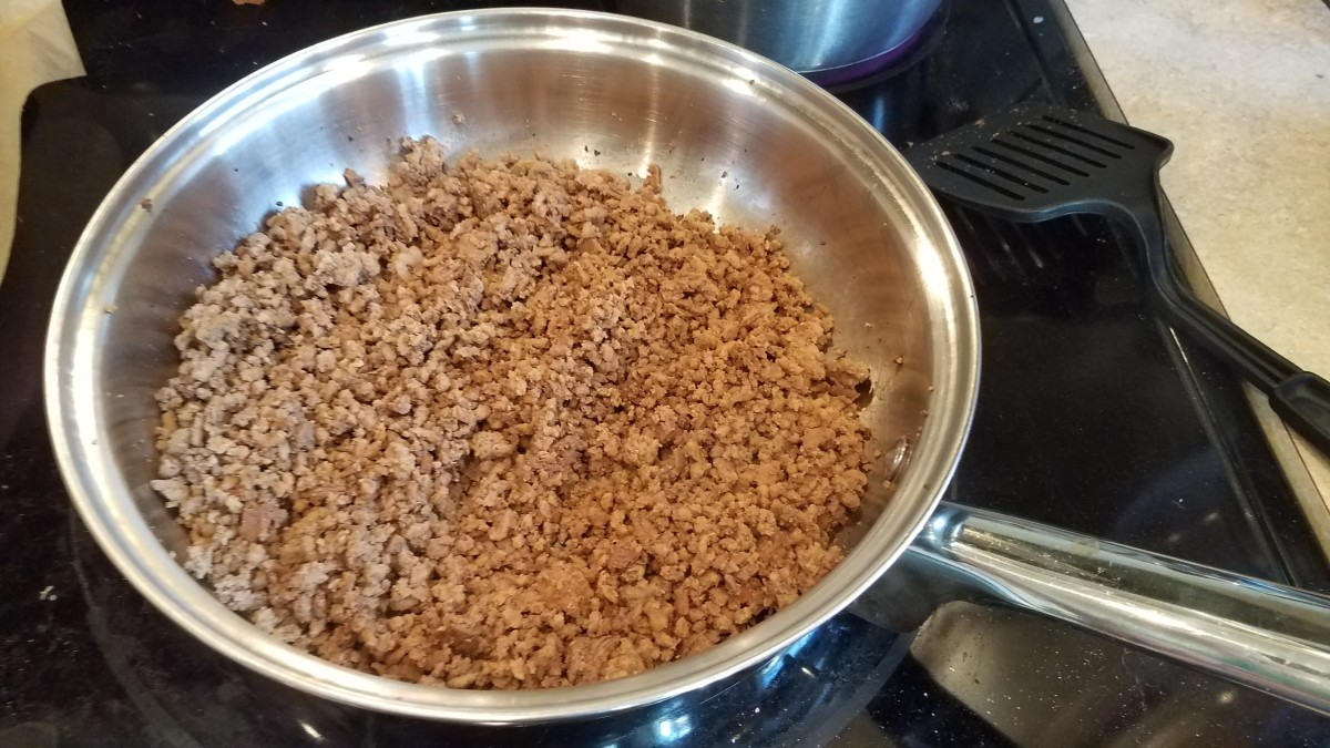Now get your hamburger cooking in a pan on the stove over medium high heat or so. Chop your onion finely and add it to the mix as well.