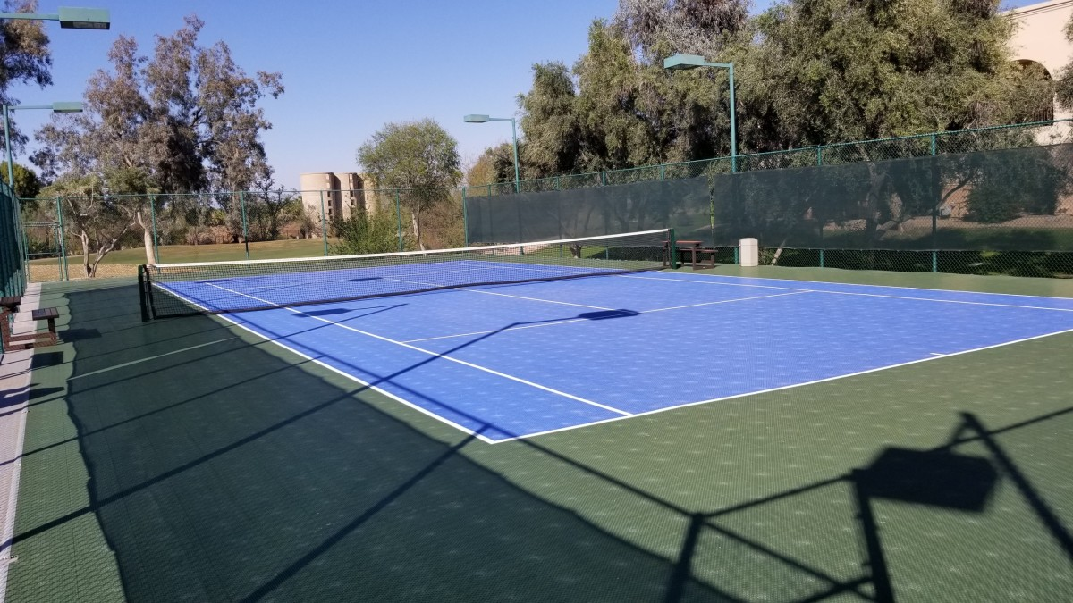 There are two tennis courts on the grounds, one of them doubles as a basketball court.