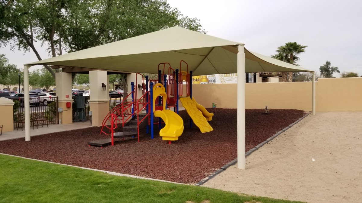The Legacy also offers a shaded playground for the kids with a soft rubberized mulch like turf.