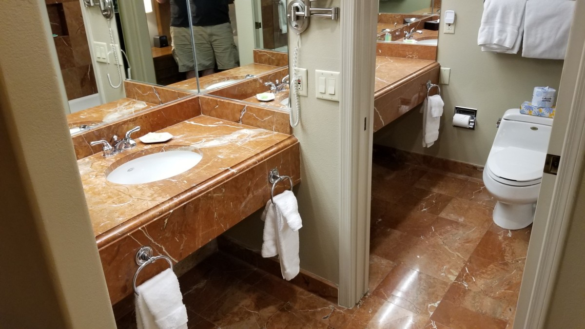 The two separate sinks can be seen here in the bathroom area.