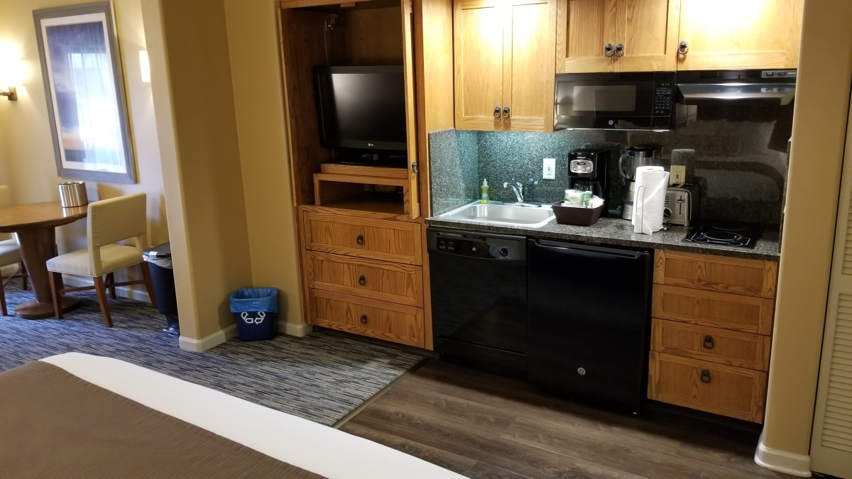 The kitchenette in the room had a dish washer, large sink, two stove tops, microwave, refrigerator (and freezer), coffee maker, blender, and much more!