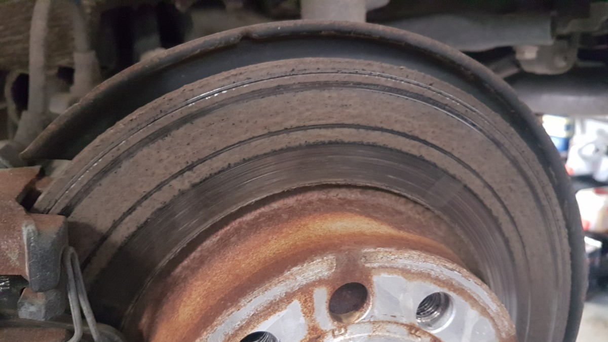 Brakes can suffer from corrosion and uneven wear if brake fluid isn't replaced at regular intervals. This brake disc is from a Volkswagen Golf which had scored discs as a result of poor quality maintenance using cheap aftermarket parts (substandard)
