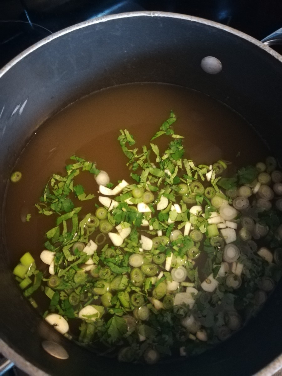 Broth with cilantro, green onion, and garlic.
