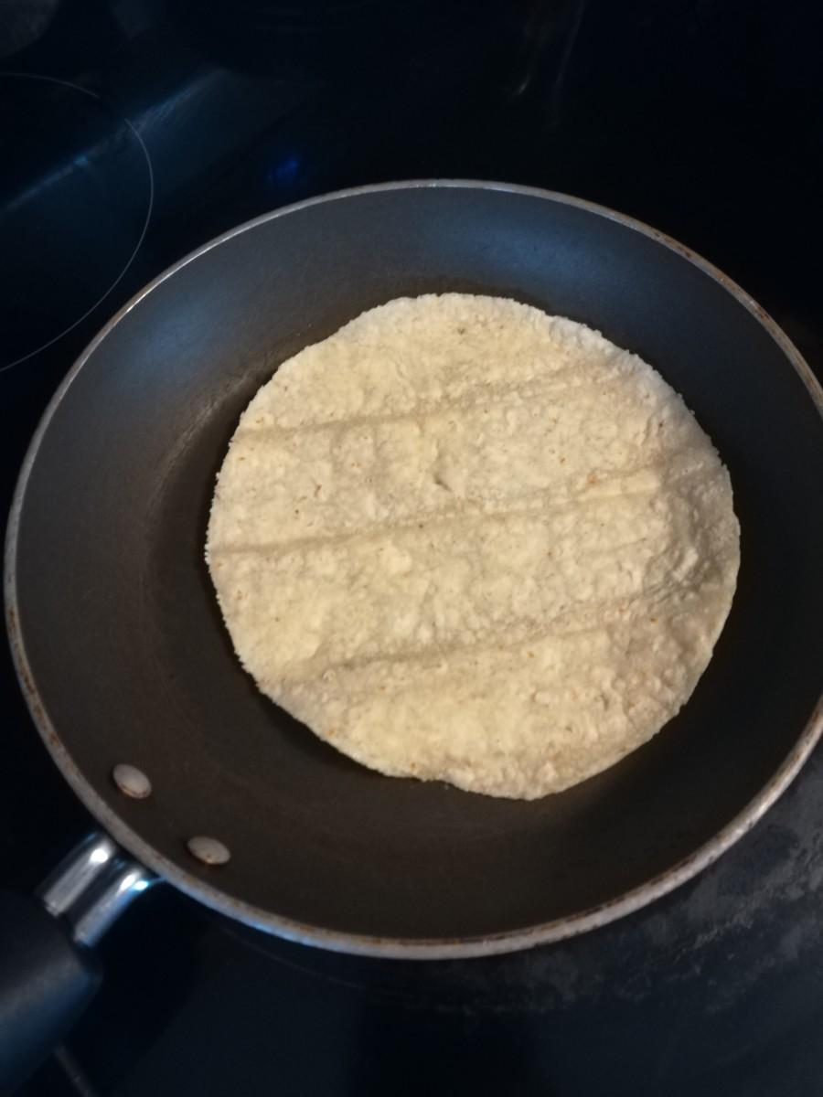 Heating a tortilla in a pan