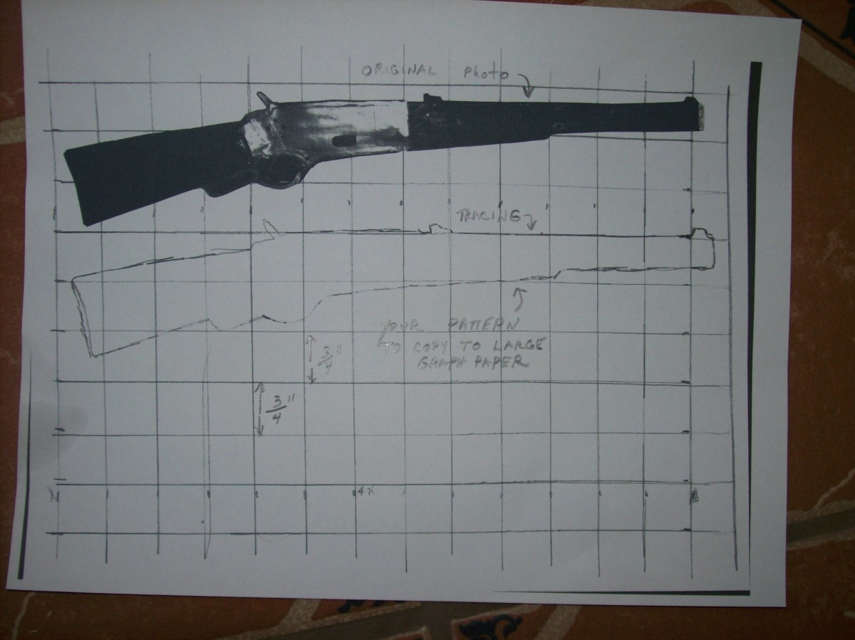 """The top image is a cutout about 10"""" long of a Winchester. The bottom sketch of the top photo is what you will use to transfer to a larger grid."""