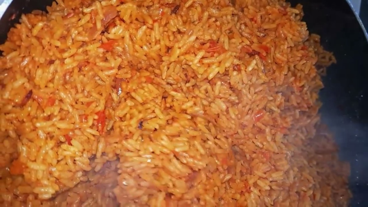 Turn off the stove and remove the pan. Open the lid and fluff the rice with a spoon or fork.