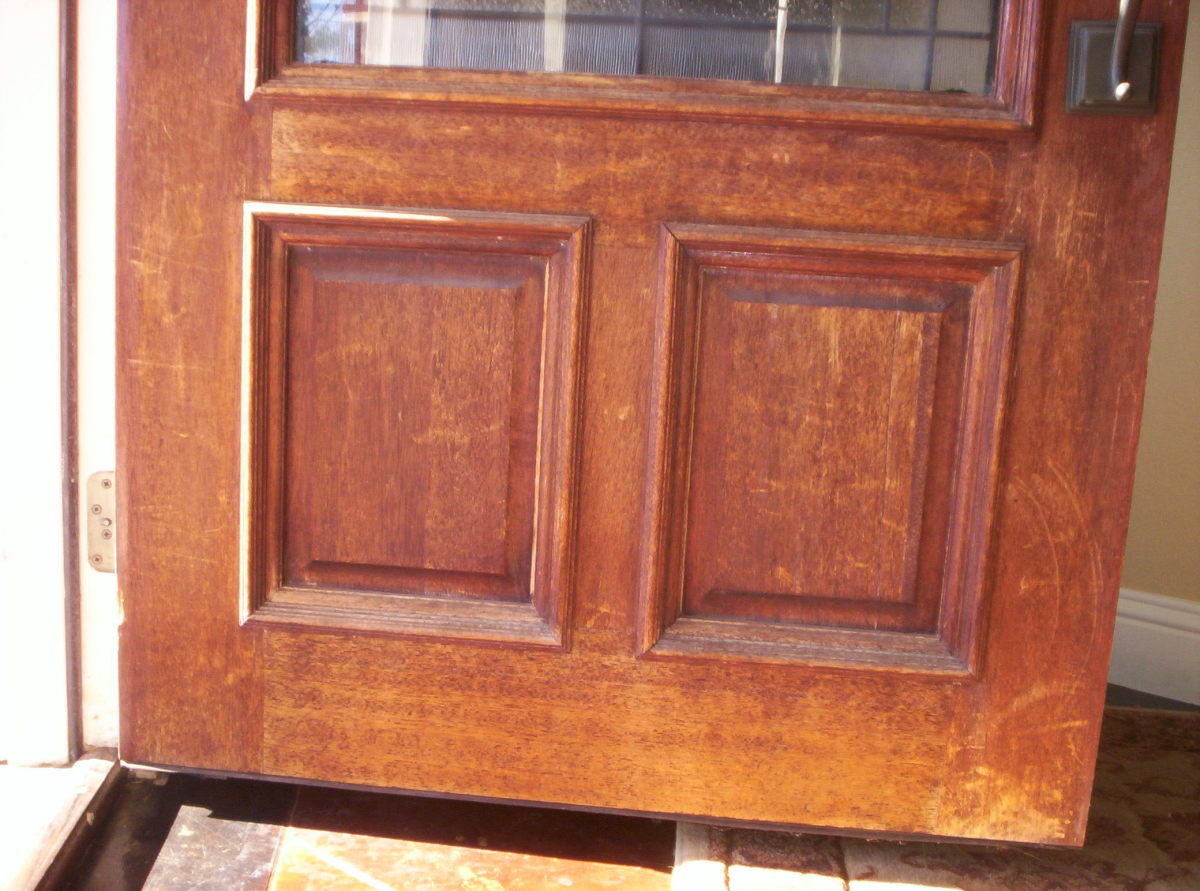 Scratched and weathered with a faded, flaking finish, our home's front door was in shoddy shape.